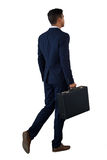 Οπισθοσκόπος του περπατήματος επιχειρηματιών με το χαρτοφύλακα Στοκ Φωτογραφία