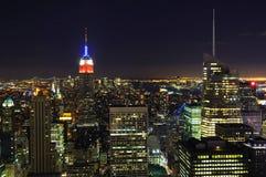 Ορίζοντας πόλεων της Νέας Υόρκης τη νύχτα Στοκ Φωτογραφία