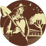 Οργανική ξυλογραφία αγροτικών κύκλων φτυαριών εκμετάλλευσης της Farmer Στοκ φωτογραφία με δικαίωμα ελεύθερης χρήσης