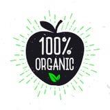 100% οργανικό - ετικέτα για τα υγιή τρόφιμα Κείμενο μέσα στο μήλο Στοκ εικόνα με δικαίωμα ελεύθερης χρήσης