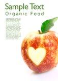 Οργανικό μήλο με τη διακοπή καρδιών στοκ εικόνες