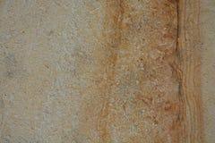 Οριζόντια γυαλισμένη φυσική φωτογραφία καφετί μπεζ Ocher αποθεμάτων υποβάθρου σύστασης επιφάνειας ψαμμίτη μαρμάρινη πέτρινη Στοκ Φωτογραφία