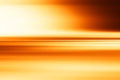 Οριζόντιο πορτοκαλί υπόβαθρο επιφάνειας θαμπάδων κινήσεων Στοκ Φωτογραφίες