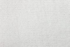 Οριζόντιο πλέξιμο λευκού ή πλεκτή πλάτη σχεδίων σύστασης υφάσματος Στοκ Φωτογραφίες