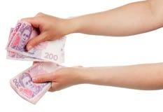 Ουκρανικά χρήματα στα χέρια Στοκ φωτογραφία με δικαίωμα ελεύθερης χρήσης