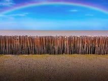 Ουράνιο τόξο πέρα από τα μπαμπού at Low Tide Στοκ Εικόνα