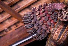 Ουρά των κινέζικων που χαράζουν το ξύλινο λιοντάρι Στοκ Εικόνα