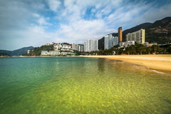 Ουρανοξύστες και παραλία Repulse στον κόλπο, στο Χονγκ Κονγκ, Χονγκ Κονγκ Στοκ Φωτογραφία