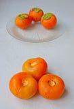 Οφέλη για την υγεία persimmon των φρούτων με τις υψηλές θερμίδες αλλά τα πολύ χαμηλά λίπη Στοκ Φωτογραφία