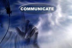 Ο άνθρωπος και το κουμπί με τη λέξη επικοινωνούν Στοκ εικόνα με δικαίωμα ελεύθερης χρήσης