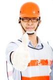 Ο άνδρας εργαζόμενος παρουσιάζει μια χειραψία Στοκ εικόνες με δικαίωμα ελεύθερης χρήσης