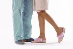 Ο άνδρας και η γυναίκα έντυσαν στην πυτζάμα Στοκ Εικόνες