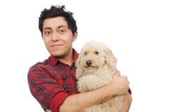 Ο άνδρας με το σκυλί που απομονώνεται νεαρός στο λευκό Στοκ Εικόνες