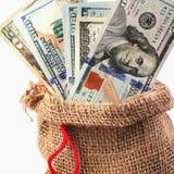 Δολάρια στην τσάντα ως σύμβολο της οικονομικής ανάπτυξης και της επιτυχίας Στοκ Φωτογραφίες