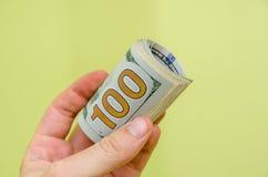 δολάρια χρημάτων εκμετάλλευσης χεριών ατόμων Στοκ Εικόνες