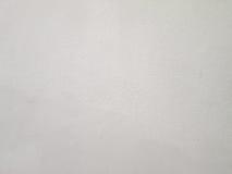 Ο άσπρος επικονιασμένος τοίχος Στοκ Φωτογραφίες
