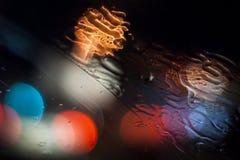 Οδήγηση κάτω από τη βροχή Στοκ Εικόνες
