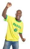 Ο ανεμιστήρας ποδοσφαίρου από τη Βραζιλία είναι ευχαριστημένος από το Παγκόσμιο Κύπελλο το 2014 στοκ φωτογραφία