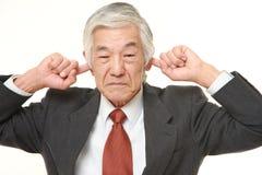 Ο ανώτερος ιαπωνικός επιχειρηματίας πάσχει από το θόρυβο Στοκ Εικόνα