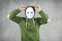 Ο απατεώνας στη μάσκα υπονοεί την κουκούλα Στοκ Εικόνα