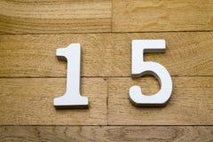 Ο αριθμός είναι δεκαπέντε στο ξύλινο, πάτωμα παρκέ Στοκ φωτογραφία με δικαίωμα ελεύθερης χρήσης