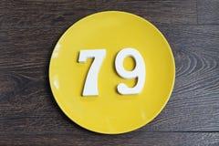 Ο αριθμός εβδομήντα εννέα στο κίτρινο πιάτο Στοκ φωτογραφία με δικαίωμα ελεύθερης χρήσης