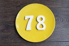 Ο αριθμός εβδομήντα οκτώ στο κίτρινο πιάτο Στοκ φωτογραφία με δικαίωμα ελεύθερης χρήσης