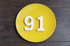 Ο αριθμός ενενήντα ένα στο κίτρινο πιάτο Στοκ φωτογραφία με δικαίωμα ελεύθερης χρήσης