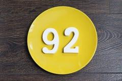 Ο αριθμός ενενήντα δύο στο κίτρινο πιάτο Στοκ Φωτογραφίες