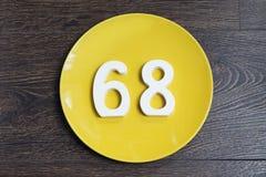 Ο αριθμός εξήντα οκτώ στο κίτρινο πιάτο Στοκ φωτογραφίες με δικαίωμα ελεύθερης χρήσης