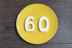 Ο αριθμός εξήντα στο κίτρινο πιάτο Στοκ εικόνα με δικαίωμα ελεύθερης χρήσης