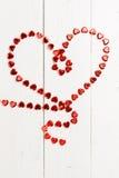 Ο αριθμός με μορφή μιας κόκκινης αλυσίδας καρδιών Στοκ Εικόνα