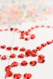 Ο αριθμός με μορφή μιας κόκκινης αλυσίδας καρδιών Στοκ Φωτογραφίες