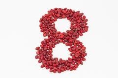 Ο αριθμός οκτώ, που γίνεται από τις κόκκινες πέτρες Στοκ Φωτογραφίες