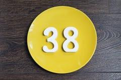 Ο αριθμός τριάντα οκτώ στο κίτρινο πιάτο Στοκ εικόνα με δικαίωμα ελεύθερης χρήσης