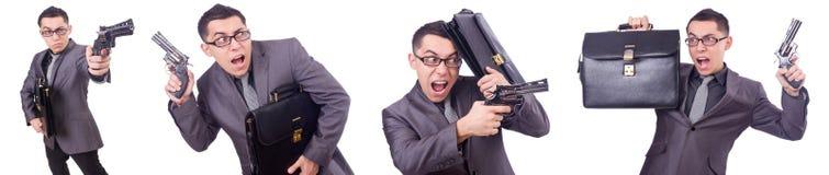 Ο αστείος επιχειρηματίας με το πυροβόλο όπλο στο λευκό Στοκ φωτογραφία με δικαίωμα ελεύθερης χρήσης