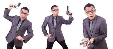 Ο αστείος επιχειρηματίας με το πυροβόλο όπλο στο λευκό Στοκ φωτογραφίες με δικαίωμα ελεύθερης χρήσης