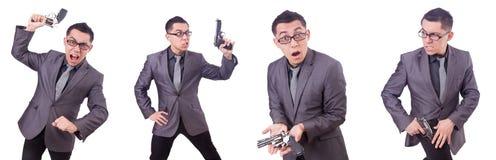 Ο αστείος επιχειρηματίας με το πυροβόλο όπλο στο λευκό Στοκ Φωτογραφία