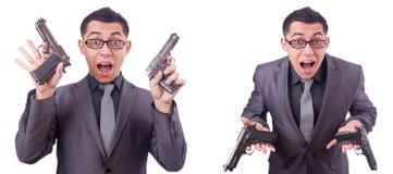 Ο αστείος επιχειρηματίας με το πυροβόλο όπλο στο λευκό Στοκ Φωτογραφίες
