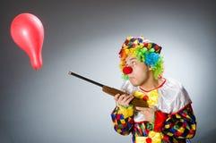 Ο αστείος κλόουν στην κωμική έννοια Στοκ Εικόνες