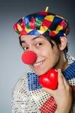 Ο αστείος κλόουν με την κόκκινη μύτη Στοκ Εικόνες