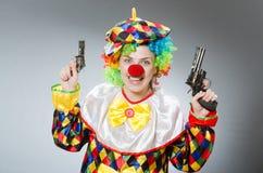 Ο αστείος κλόουν στην κωμική έννοια Στοκ Φωτογραφίες