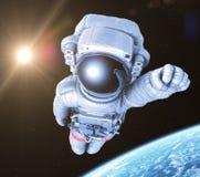 Ο αστροναύτης σε διαστημικό, τρισδιάστατος δίνει, Στοκ Φωτογραφίες