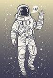 Ο αστροναύτης στη φόρμα αστροναύτη αυξάνει παραδίδει το χαιρετισμό Στοκ φωτογραφία με δικαίωμα ελεύθερης χρήσης