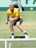 Ο αυστραλιανός τενίστας Sam Groth κατά τη διάρκεια του φλυτζανιού του Νταίηβις ξεχωρίζει ενάντια στο John Isner Στοκ Εικόνα