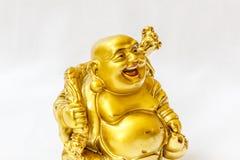 Ο γελώντας Βούδας χρωμάτισε στο χρυσό χρώμα με το άσπρο σκηνικό Στοκ φωτογραφία με δικαίωμα ελεύθερης χρήσης