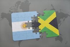 ο γρίφος με τη εθνική σημαία της Αργεντινής και η Τζαμάικα σε έναν κόσμο χαρτογραφούν το υπόβαθρο Στοκ εικόνα με δικαίωμα ελεύθερης χρήσης