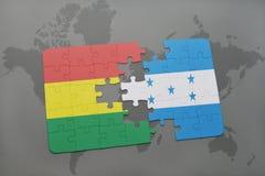 ο γρίφος με τη εθνική σημαία της Βολιβίας και η Ονδούρα σε έναν κόσμο χαρτογραφούν το υπόβαθρο Στοκ εικόνες με δικαίωμα ελεύθερης χρήσης