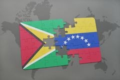 ο γρίφος με τη εθνική σημαία της Γουιάνας και η Βενεζουέλα σε έναν κόσμο χαρτογραφούν το υπόβαθρο Στοκ εικόνα με δικαίωμα ελεύθερης χρήσης