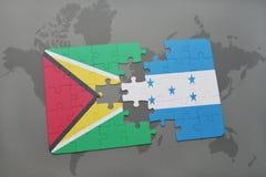 ο γρίφος με τη εθνική σημαία της Γουιάνας και η Ονδούρα σε έναν κόσμο χαρτογραφούν το υπόβαθρο Στοκ φωτογραφία με δικαίωμα ελεύθερης χρήσης